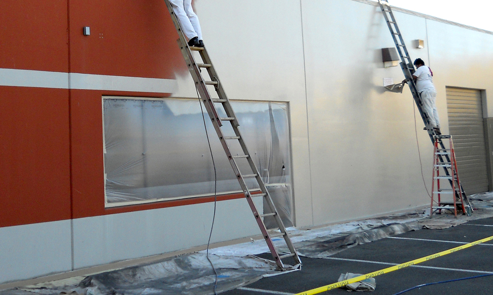 Commercial building exterior mid repainting