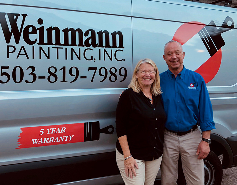 Portrait of owners Lori and Kevin in front of a Weinmann painting van