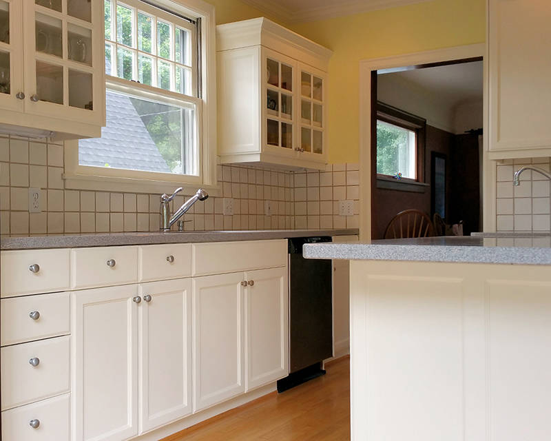 Freshly painted white kitchen cabinets