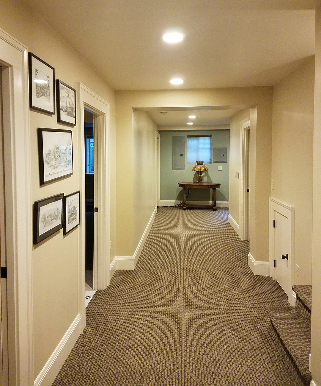 Halway of home with freshly painted lined colored walls
