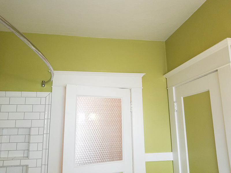 Interior paint with light green and white trim walls