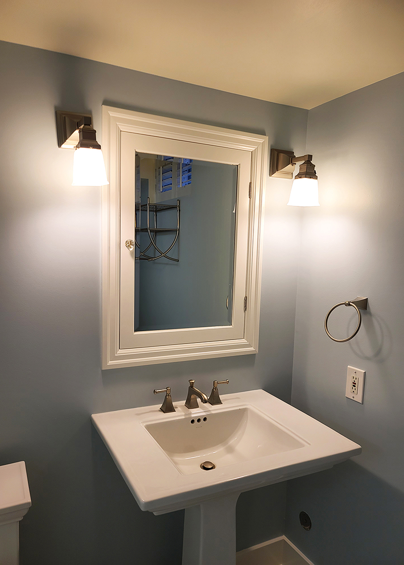 Freshly painted bathroom with Hazel, White Glove, and